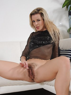 Lenny pushes her dildo in and out of her pretty pink hairy pussy  and it feels great. She gently holds her lips open and her clit back as she drives it deeper.