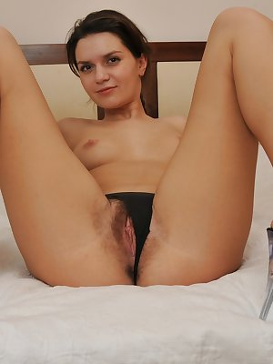 Lara strips down to the raw and shows off her juicy pink bush. With a finger on either side of her hairy pussy lips, she gently opens it wide so you can see it drip.