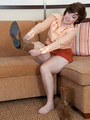 Curvy minx Simone leaves her boots on, but quickly pulls off her short skirt and points her hairy ass in the air! She can't wait to be fucked hard on the sofa!