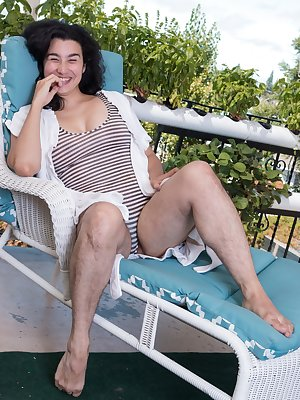 Wara is relaxing on her balcony in her lounge chair. She slowly undresses and shows us her hairy legs, bush, and pits. She totally enjoys showing her naturally hairy body off in the sun today.