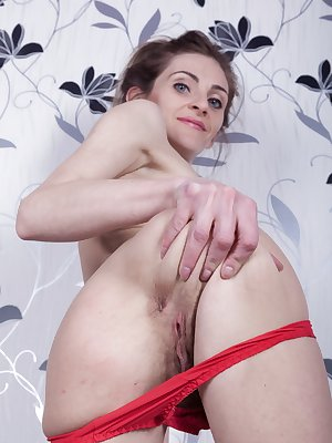 Olivia Arden is relaxing on her sofa in a floral outfit and strips naked after. She enjoys her hairy pussy and then gets her glass dildo. She fucks her pussy hard and enjoys hot orgasms from getting off.