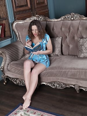 Dominique is in all blue reading book on her couch and touching her hairy pussy and hairy pits. She strips naked feeling sexy, and touches her body all over, and enjoys her naturally hairy body.