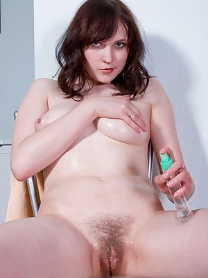 Alena's beautiful natural goodies will bring a tear to your eye as she slowly strips off, oils up and rubs her moist hairy pussy on a dripping chair