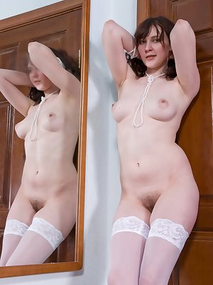All natural brunette nympho Alena loves to be watched as she cheekily teases the camera with her soft pale body, perky rack and juicy hairy pussy.
