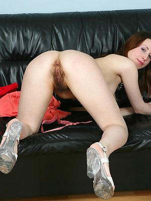 Slender hairy nympho Jasmine feels so sexy in her high heels and mini skirt. Have a peek up it, you might just see her thick moist hairy pussy!