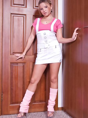 Babydoll Snezha looks gorgeous in her under bust overalls. They are so short you can nearly see her hair tufts poking out the bottom. Take a closer look as she bares it all.