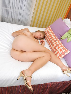 Soft, pink and hairy are only a few words to describe April and her tightly packed natural body and bush. Don't wait, see her spread across the covers!