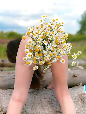 Join Anna R on a all natural outdoor adventure. Help her pick some flowers and then wave her hairy bush in the wind and sun.