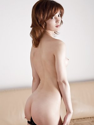 Gorgeous, petite Karin has the perfect body and sweetest face...she is so cute when she strokes her furry pussy.