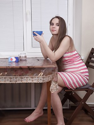 Sirena is sitting at her table in her pink dress. She has hairy legs and a hairy pussy and is quite adorable. She enjoys some coffee while showing off her hairy body and even her hairy pits too.