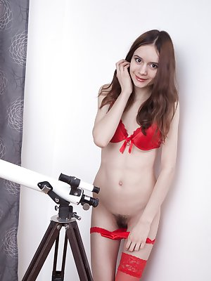 Lolita is enjoying looking at the stars in her red lingerie. She trips naked feeling horny after, and shows her hairy pits and pussy. She then masturbates on her couch nearby to orgasm and relax.