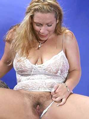 Blonde mature pornstar Yoko guzzling a cock down her throat and taking it in her hirsute slit