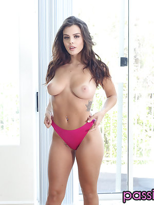 Latina solo model Keisha Grey bares her big tits as she removes her clothes