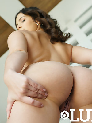Teen girl with a delicious ass soaps and foams herself and fingers her pussy