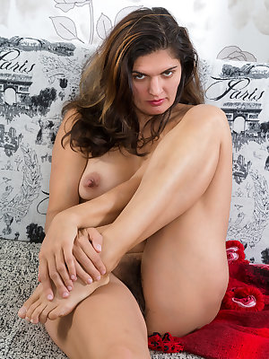 Brunette Ananda Ray sheds black dress to pull her hairy pussy lips apart to