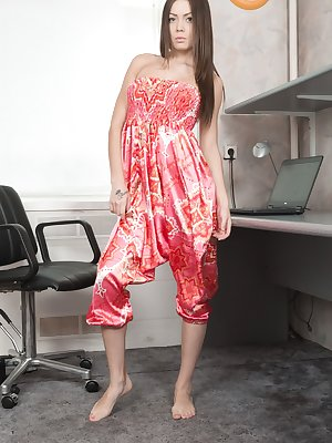 Lou is a long haired beauty, and slides off her red dress to show us her natural body. She then climbs on her desk, shows us her hairy pussy with legs spread wide open, and looks quite stunning right?