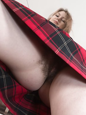 Kira Tomson is young and playing around in her plaid skirt. You can see her hairy pussy up her skirt, and as she strips naked. Laying on the floor, fingers slide inside and she masturbates for us.