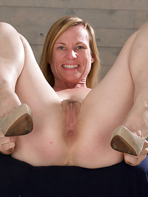 Mature woman Cody Hunter sheds her white lingerie and heels for nude posing