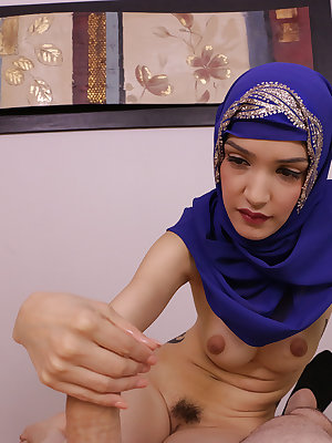 Arabian female Jericha Jem jerks off a large penis in POV mode