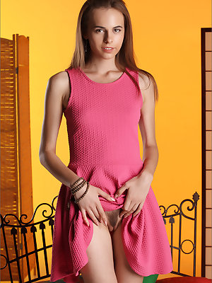 Slutty young teen hikes her pink dress to spread pussy with her fingers