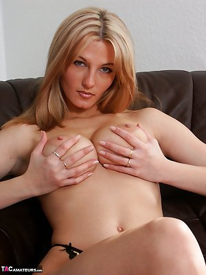 Sultry blonde Vanessa fondles saggy boobs & spreads legs to show trimmed pussy