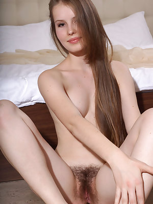 Lustful brunette filly Victoriya A loves spreading her hirsute pussy