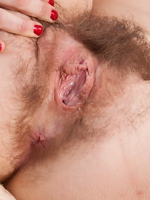 Young Snow exhibits hairy armpits and spreads lips for hairy pussy closeup