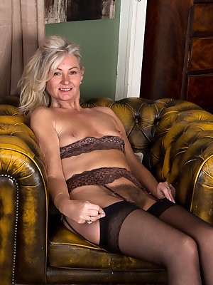 Old mature Ellen B peels off her sheer shirt and shows off her saggy tits