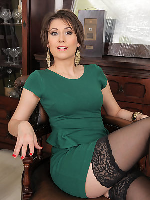 Beautiful MILF Meggie in stockings flashes hairy pussy and toys with vibrator