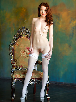 Elegant redhead poses in pearls and white stockings to flaunt her hairy muff