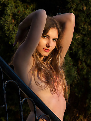 Gorgeous slut Zoeya shows her hairy pussy naked on the steps outside