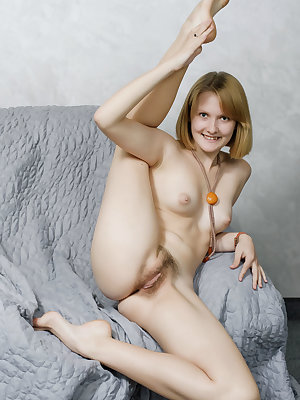Petite young girl shows off her flexible body during nude poses