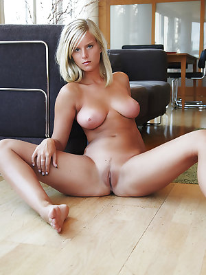 Busty brazen Miela offers up her spread ass and bald twat for the taking