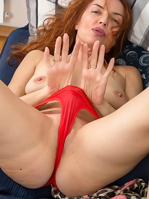 Hot redhead vixen Monica S discards her red lingerie to showoff spread pussy