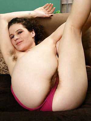 Older hirsute model Sunshine proudly shows off her all natural vagina