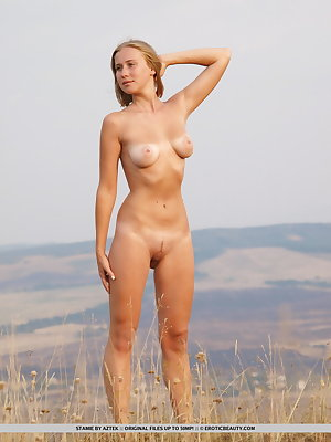 Young blonde Stamie takes a dare and romps naked on the country walking path