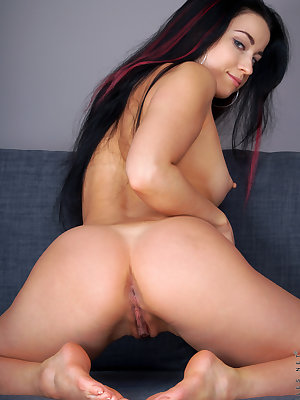 Dark haired cutie Taissia Shanti shows perky breasts spreading pussy lips wide