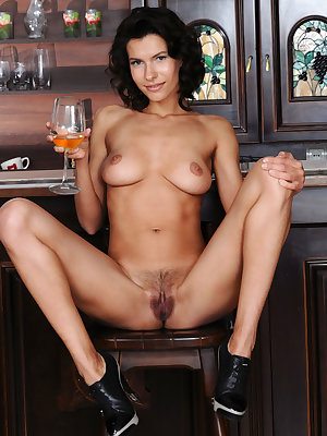 Brunette female Suzanna A slips off her leather top and miniskirt at the bar