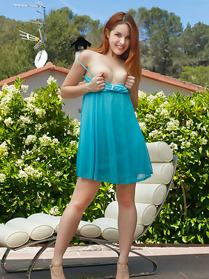 Cute redhead Amarna Miller slips off sun dress to pose nude on lounge chair