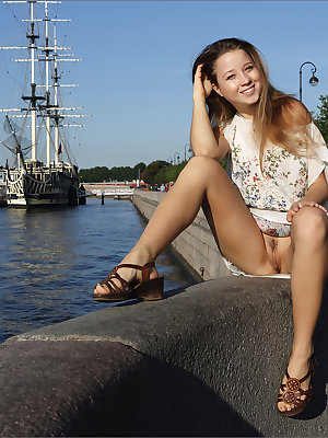 Leggy beauty gives naked upskirt on the pier then strips completely naked