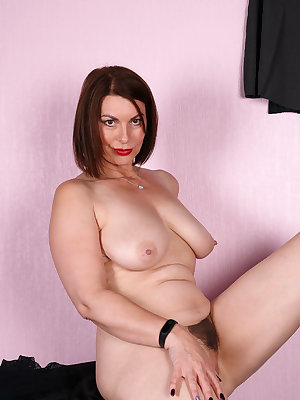 Mature hot Raven in leather lingerie & stockings with whip flaunting big ass