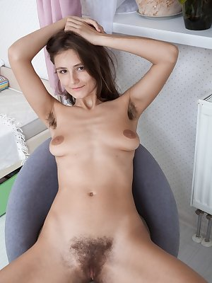 Amateur solo girl Shivali parts her hairy cunt wide open for the first time