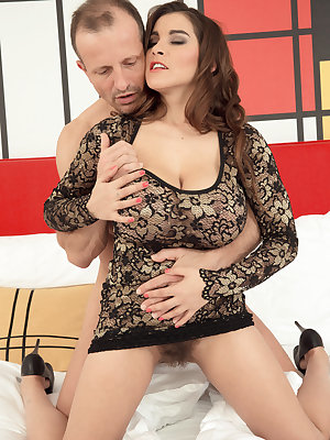 Big titted female Mischel Lee sucks the jizz out of her man's dick