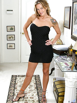 Middle-aged blonde chick hikes up her black dress to show her bush