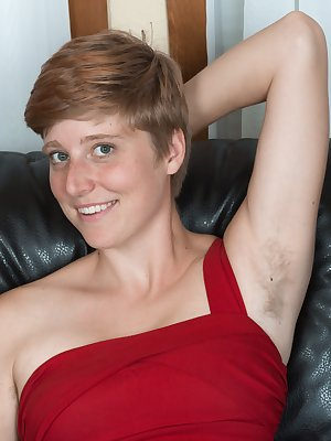 """Aurora Odaire is on her leather couch in a red dress reading a book. She strips after done reading and shows her hairy pits and pussy. She is sexy and 5'8"""", and has a beautiful hairy bush to enjoy."""
