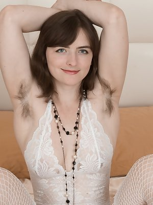Snow is in her bed wearing her white lingerie and white stockings. She lays back with her hairy pits showing and her hairy pussy showing too. She then masturbates with her pink vibrator to orgasm.