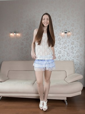 Cherry Bloom poses and strips naked on her white couch. She has hairy pits and a hairy bush, and is all natural. She lays back on the couch, and her 23 year-old body is hairy all over.