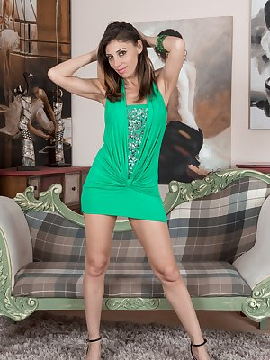 Chloe R is seductive in her green dress and panties, and climbs across her couch to show her body off. She strips naked and then spreads her legs, showing us her hairy pussy and slender sexy body.