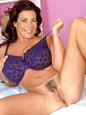 Appealing brunette Linsey Dawn McKenzie plays a cute solo showing big tits