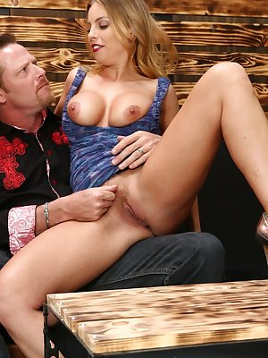 Bare legged pornstar Brittany Amber sports a creampie after getting banged